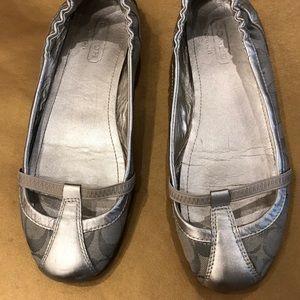 Coach silver ballet slip on.  So 8